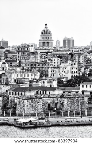 Hiigh contrast black and white image of Havana with several landmarks and very old buildings - stock photo