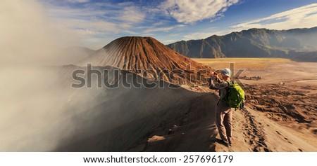 Hike in Bromo volcano - stock photo