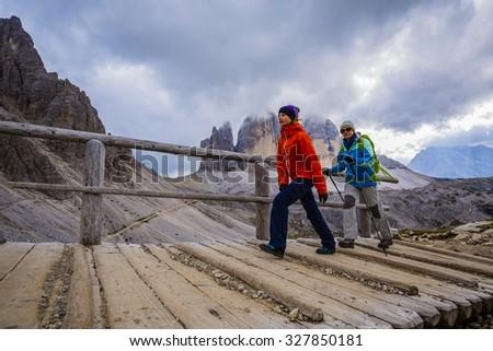 Hike mountain in the Dolomites, the trail Tre Cime di Lavaredo - stock photo