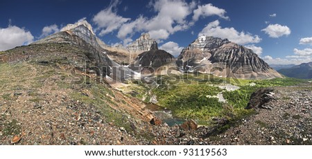 Hike To Mount Eiffel Summit, Near Lake Louise, Banff National Park, Alberta, Canada  (l-r) - Eiffel Mountain, Pinnacle Peak, Mount Temple, Larch Valley (Center) and the Trail back to Moraine Lake. - stock photo