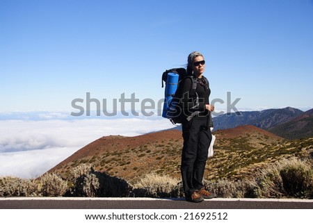 Hiker above the clouds, Tenerife, Spain