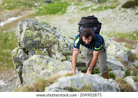 Hiker alone in Romanian Carpathians, Parang mountains - stock photo