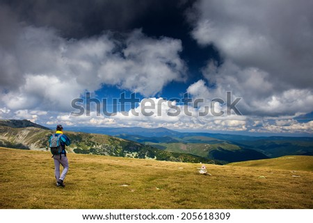 Hiker alone in Romanian Carpathians, Parang mountains