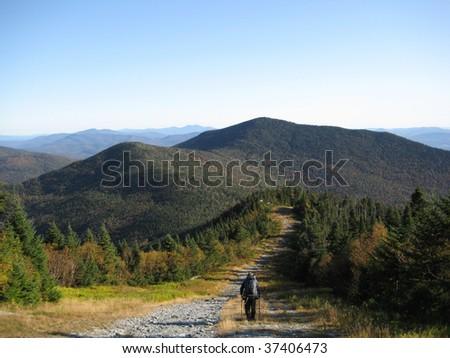 Hiker along ridge in Vermont - stock photo