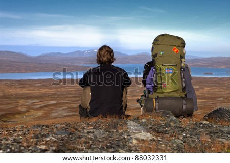 Hiker and Backpack - stock photo