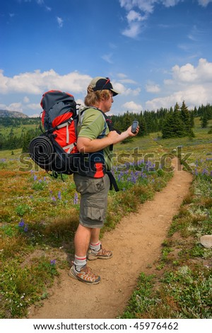 hiker and GPS - stock photo