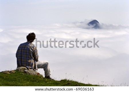 Hiker and sea of clouds on natural park, Euskadi - stock photo