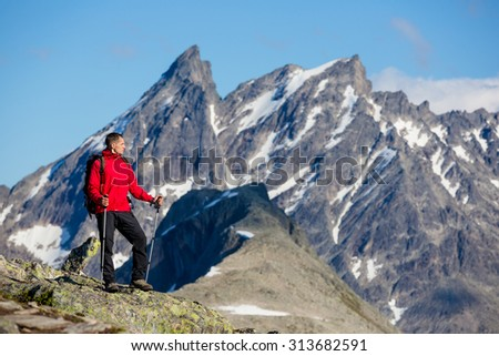 hiker at the top enjoy sunny day - stock photo