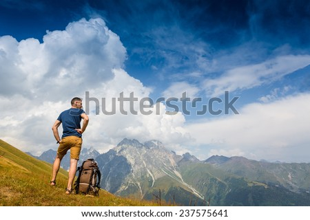 hiker at the top enjoy sunny day in summer mountains  - stock photo
