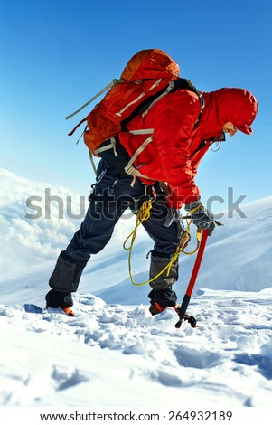 hiker at the top of a pass with backpacks meeting the sunrise in the mountains - stock photo