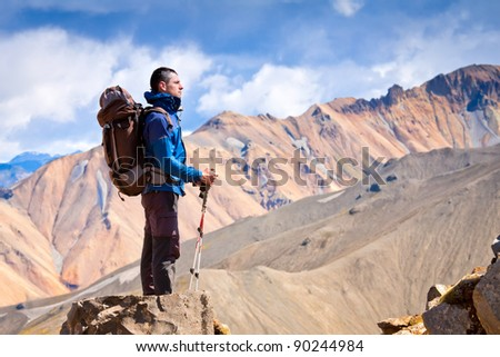 hiker at the top of a rock - stock photo