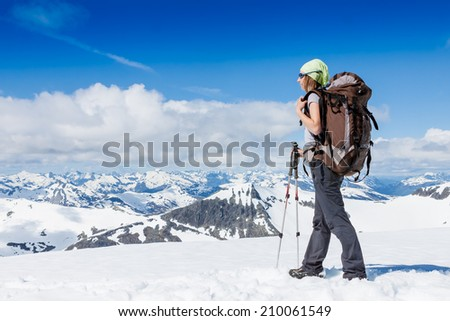 hiker at the top with backpack enjoy sunny day  - stock photo