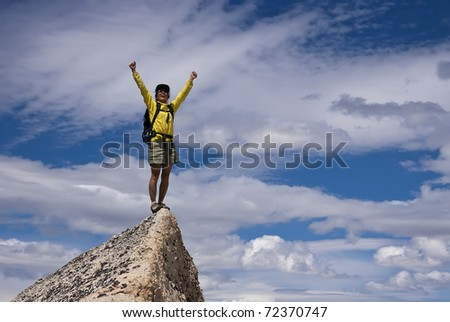 Hiker  celebrates on the summit. - stock photo