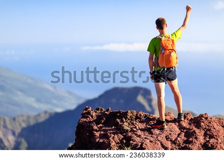 Hiker climber or trail cross country runner man and success in mountains. Fitness and healthy lifestyle outdoors in summer nature, climbing and mountaineering concept - stock photo