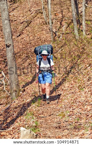 Hiker coming down the Long Hungry Ridge trail in the Smoky Mountains - stock photo