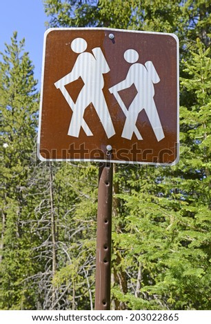 Hiker Crossing sign along road in the Forest - stock photo