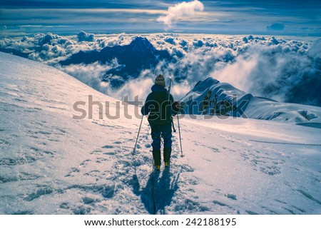 Hiker descending from top of Huayna Potosi mountain in Bolivia - stock photo