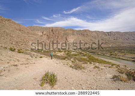Hiker Enjoying the Desert View by Boquillas Canyon in Big Bend National Park in Texas - stock photo