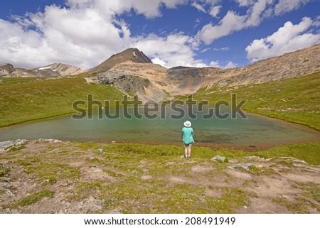 Hiker Enjoying the View of Helen Lake in Banff National Park - stock photo