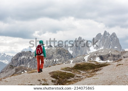 hiker girl at the italian mountains,  Alps  - stock photo