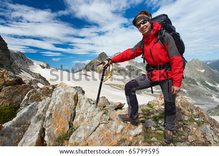 Hiker girl in Caucasus mountains - stock photo