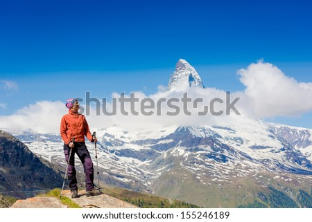 Hiker girl in the mountains