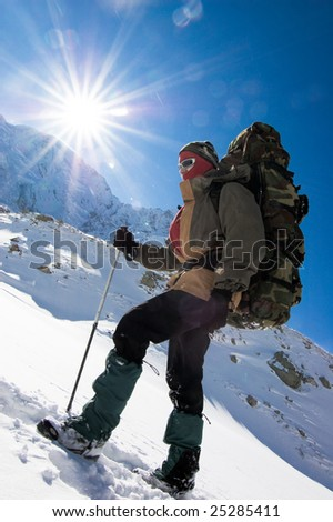 Hiker go up in mountains