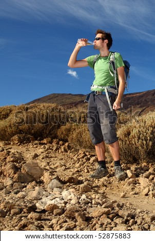 hiker hiking and drinking - stock photo