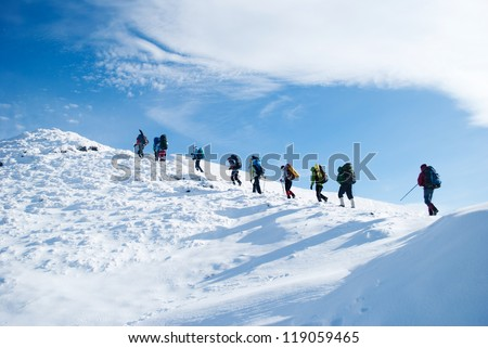 hiker in a winter mountain - stock photo