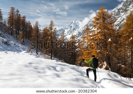 Hiker in a winter mountain landscape, Mont Blanc, Italy - stock photo