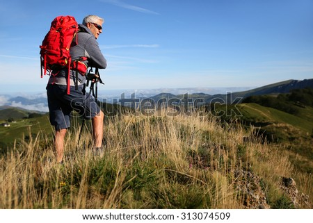 Hiker in Basque country mountains looking at scenery - stock photo