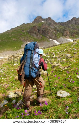 Hiker in Caucasus mountains