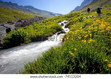 Hiker in Caucasus mountains - stock photo