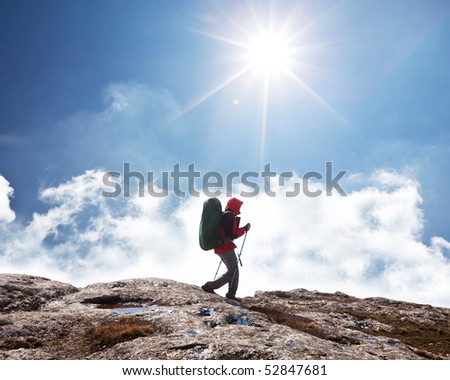 Hiker in Himalayan mountains - stock photo