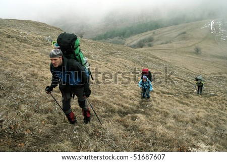 Hiker in mountains - stock photo