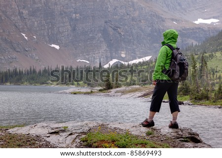 Hiker in Rainy Weather - stock photo