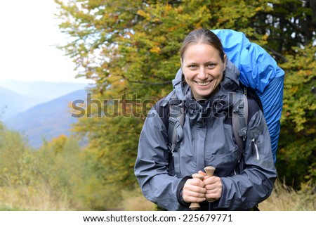 Hiker in the autumn mountains. - stock photo