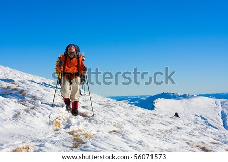 Hiker in winter in mountains