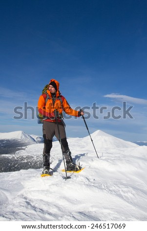 Hiker in winter mountains. - stock photo