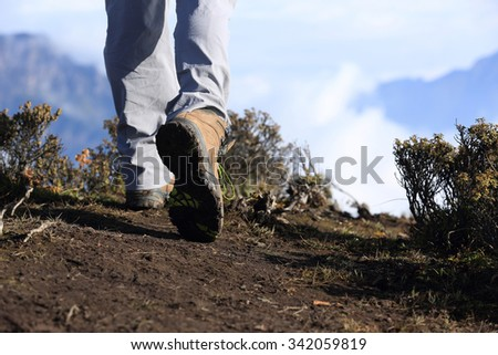hiker legs stand on mountain peak