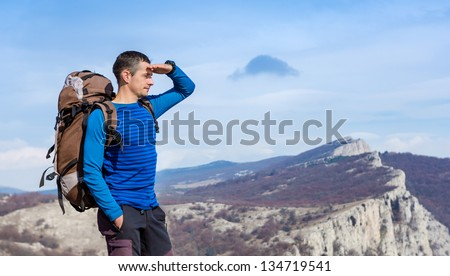 hiker looking at the horizon - stock photo