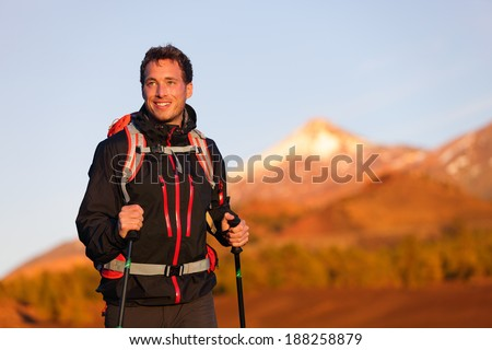 Hiker man hiking living healthy active lifestyle. Trekking male model walking in beautiful mountain nature landscape on volcano Teide, Tenerife, Canary Islands, Spain. - stock photo