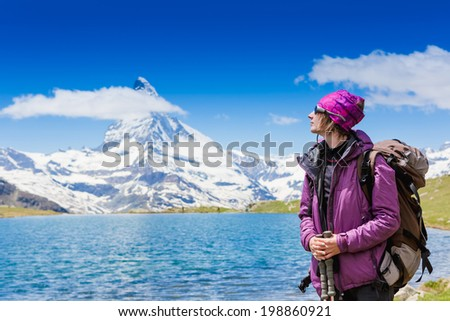 hiker near Matterhorn enjoy sunny day  - stock photo