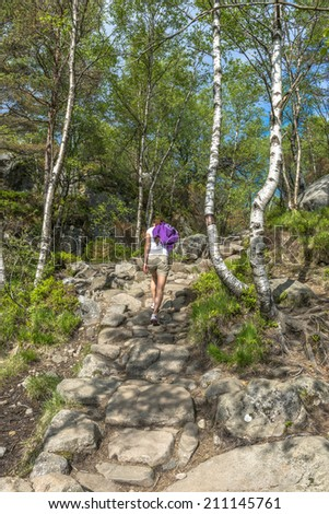 Hiker near Pulpit Rock in Norway - stock photo