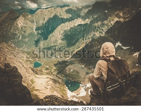 Hiker on a top of a mountain  - stock photo