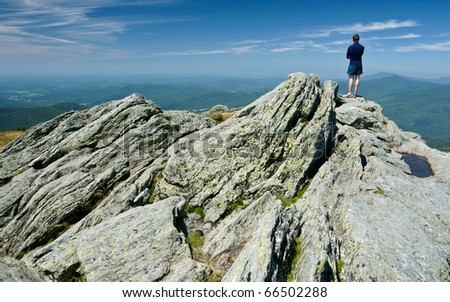 Hiker on Camels Hump in Vermont, which is part of the Long Trail. - stock photo