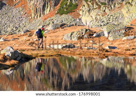 Hiker on glacier lake side  - stock photo