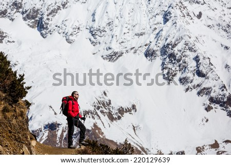 hiker on mountains - hiking in Nepal - stock photo