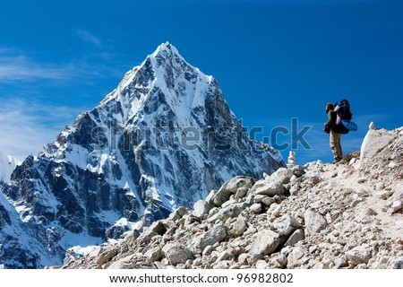 hiker on mountains - hiking in Nepal - way to everest base camp - stock photo