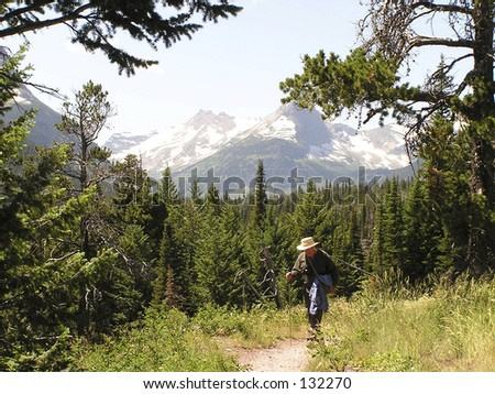 hiker on path of East Glacier National Park, Montana - stock photo